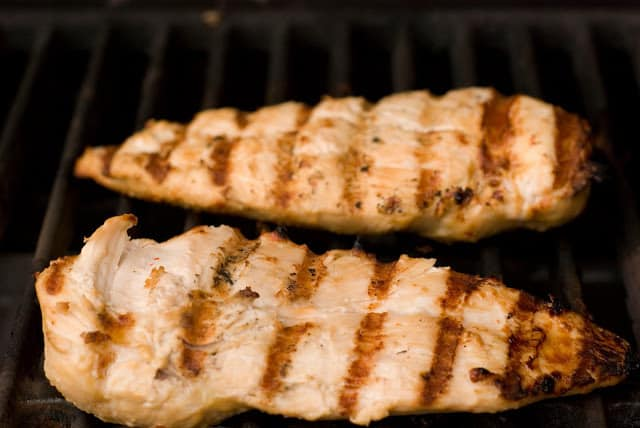 chicken breasts with grill lines on grill