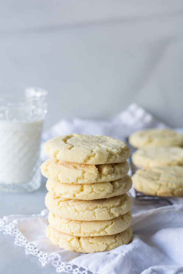 stacked sugar cookies glass of milk