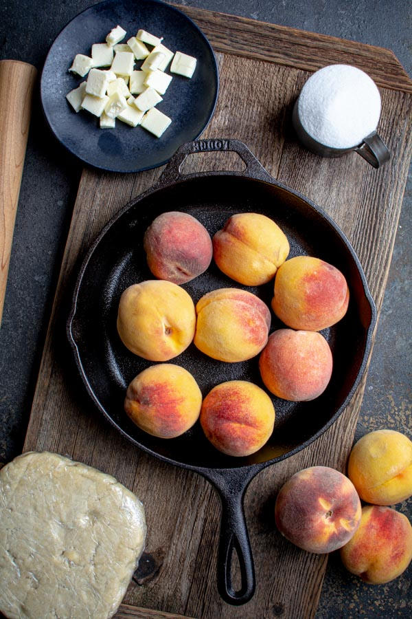cast iron skillet filled with fresh peaches