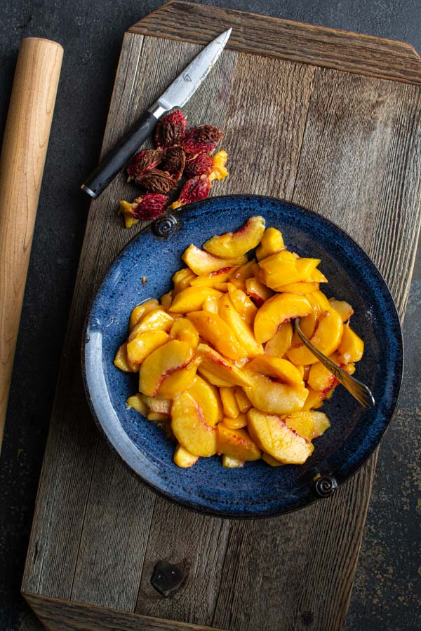 Large blue bowl with peach slices