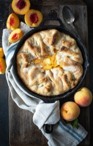 Baked southern peach cobbler on a wooden board