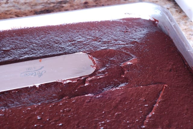 Spreading brownie mixture in baking pan