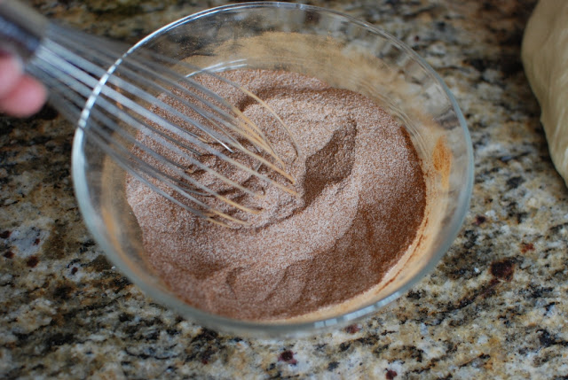 Sugar and cinnamon mix in a bowl