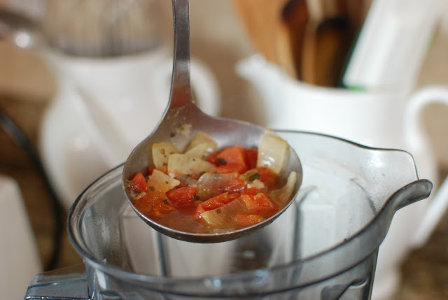 Ladle of soup over blender container