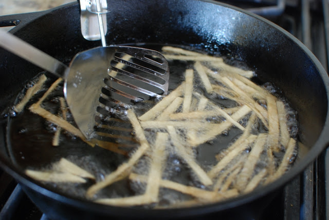Frying tortilla strips on hot oil