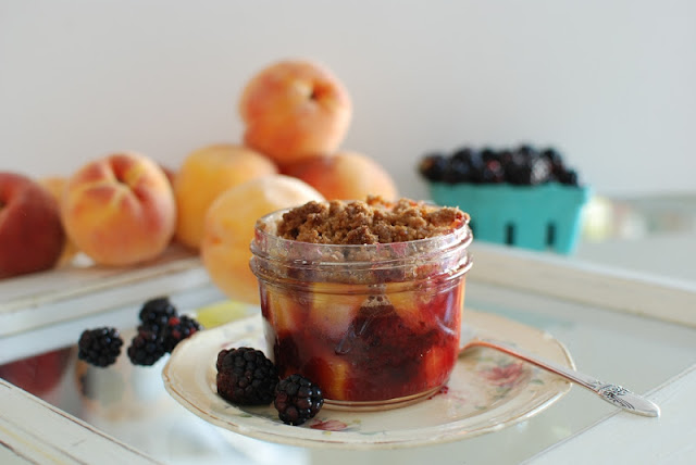 mason jar filled with blackberry peach crisp