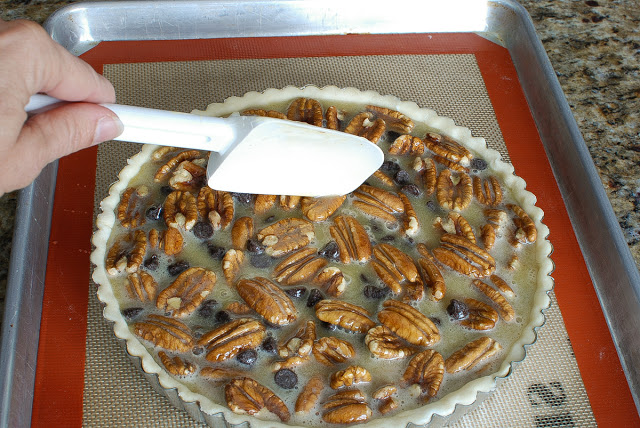 Smoothing surface of pecan pie