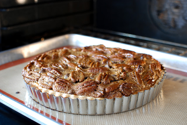 removing baked pecan tart from oven