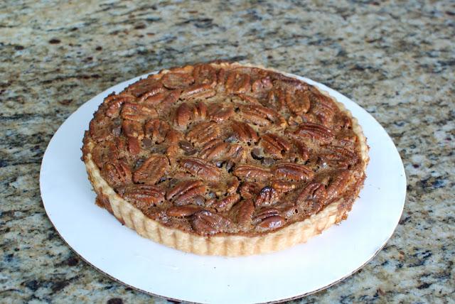 pecan tart on cardboard round