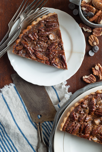 Slice of pecan chocolate tart on plate