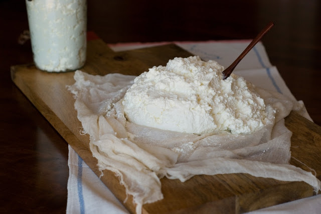 ricotta on cheese cloth on a board