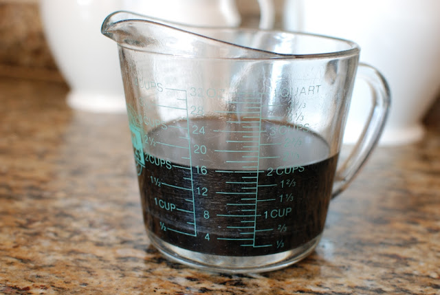 reduced cherry cola in measuring cup