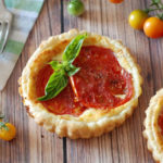 Small round pastry with ricotta and fresh tomato