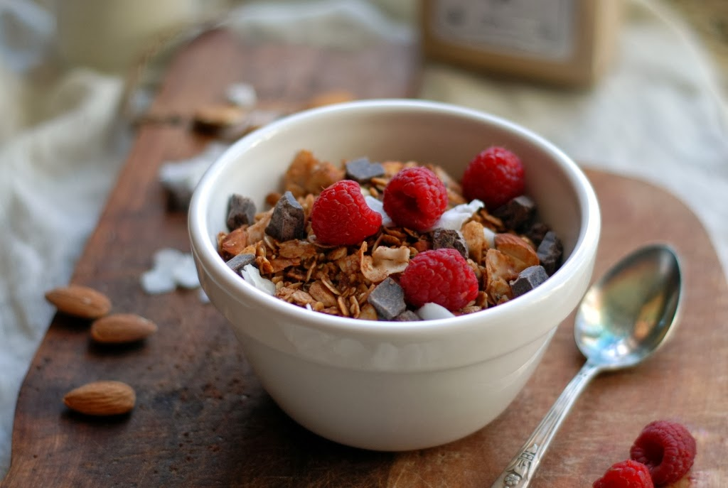 bowl of granola with fresh raspberries