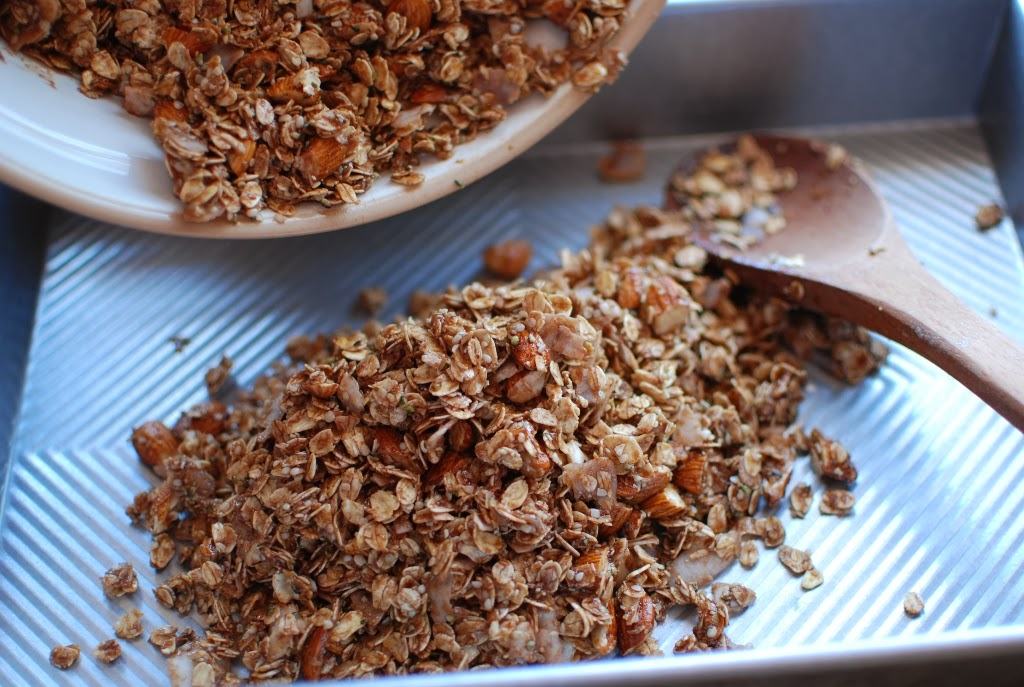granola mixture added to baking pan