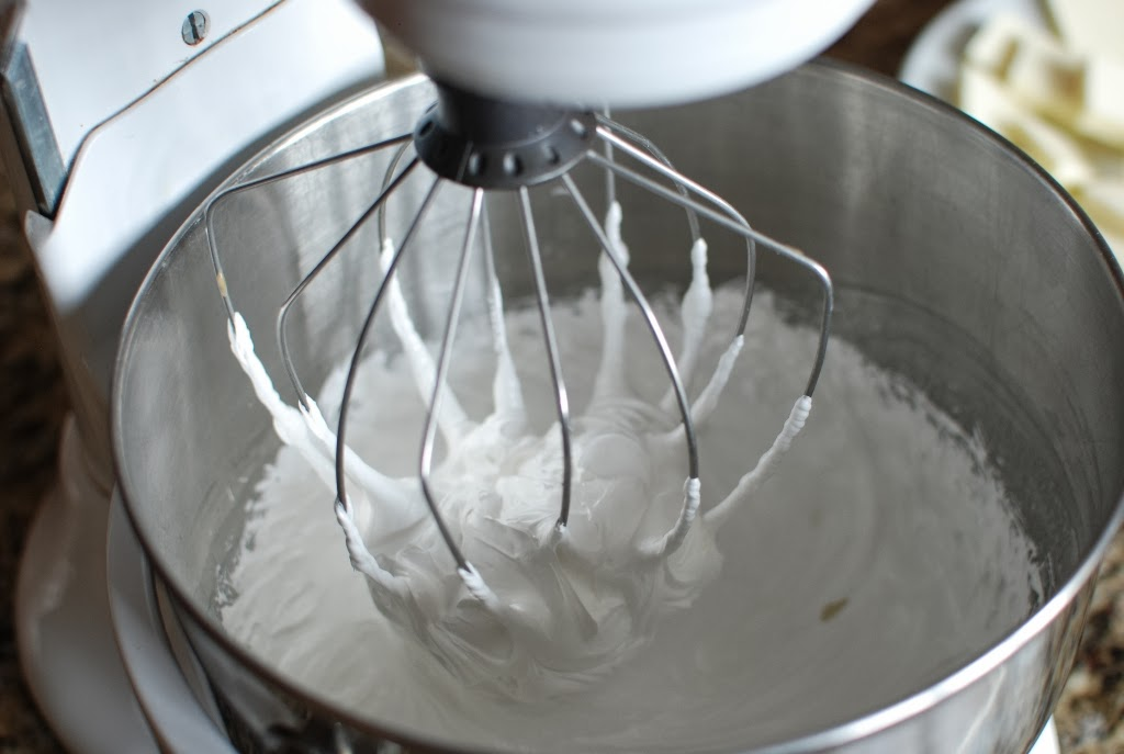 Swiss Meringue in mixing bowl with a large wire whisk attachment