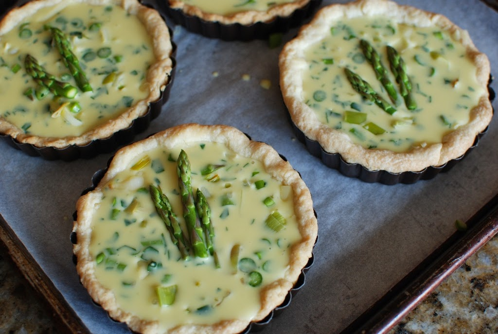 Quiche topped with asparagus tips