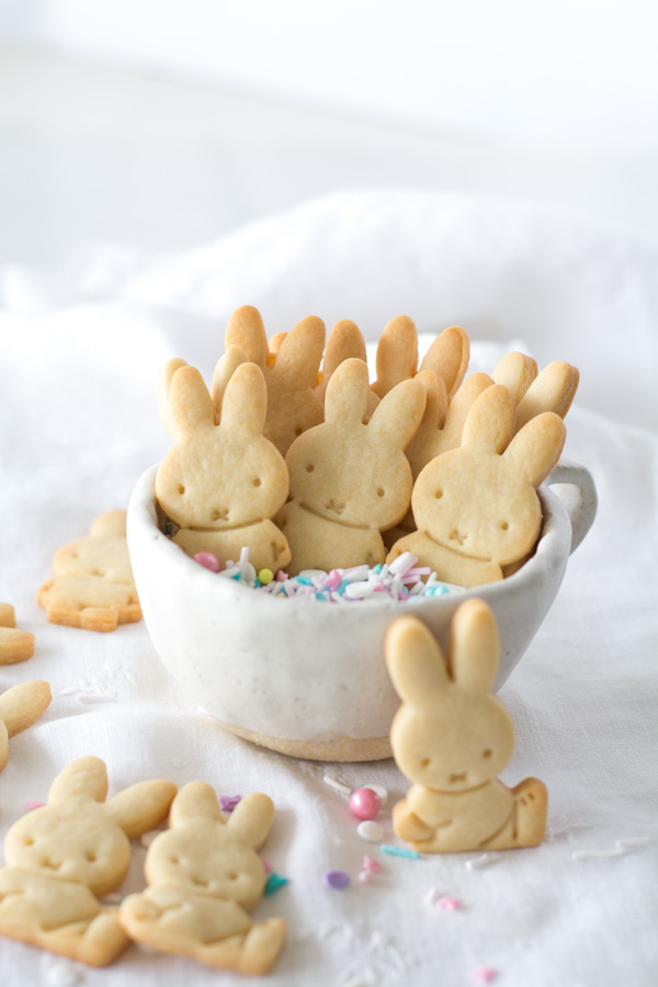 white cup with sprinkles and bunny cookies