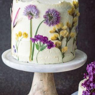pressed flowers decorate lemon olive oil cake