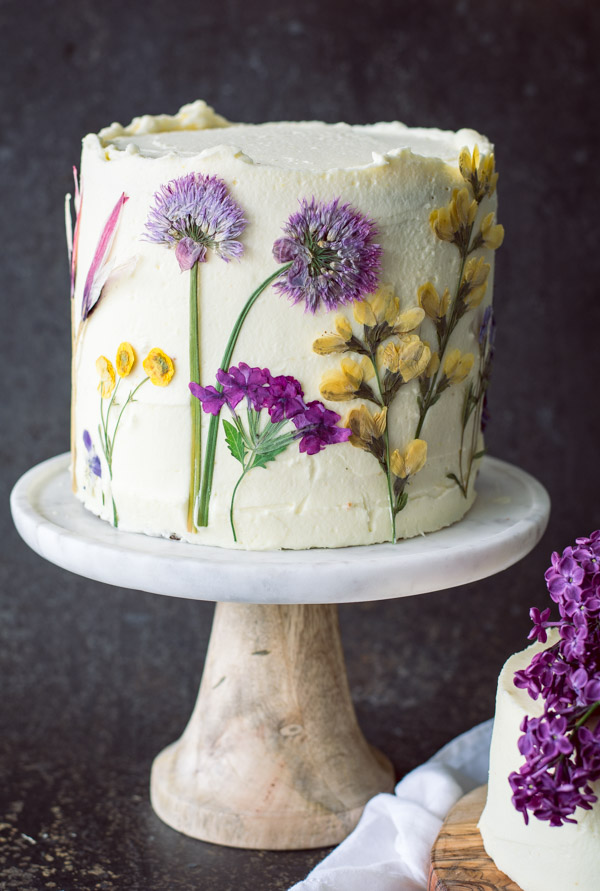 pressed flowers decorate lemon olive oil cake