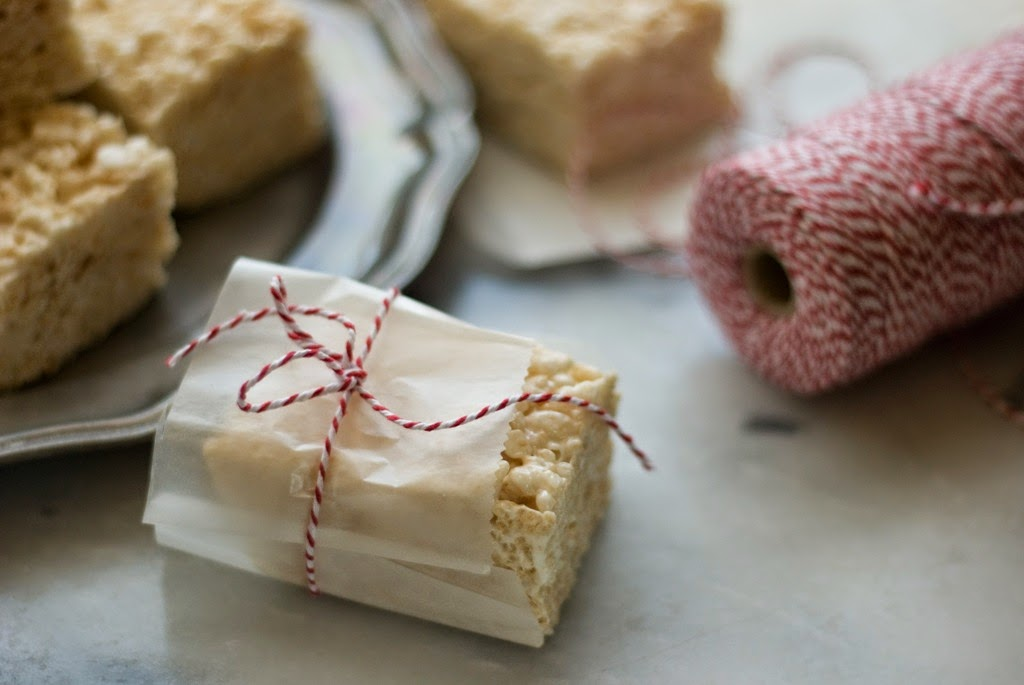 Cut rice crispy treats wrapped in waxed paper bakers twine