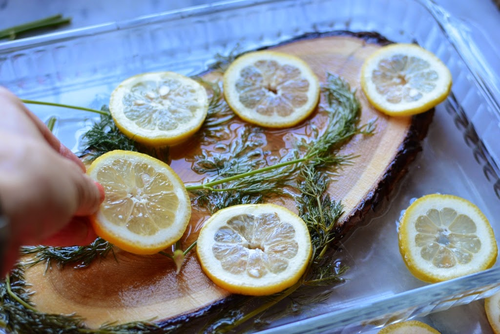 cedar plank in water with lemon and dill