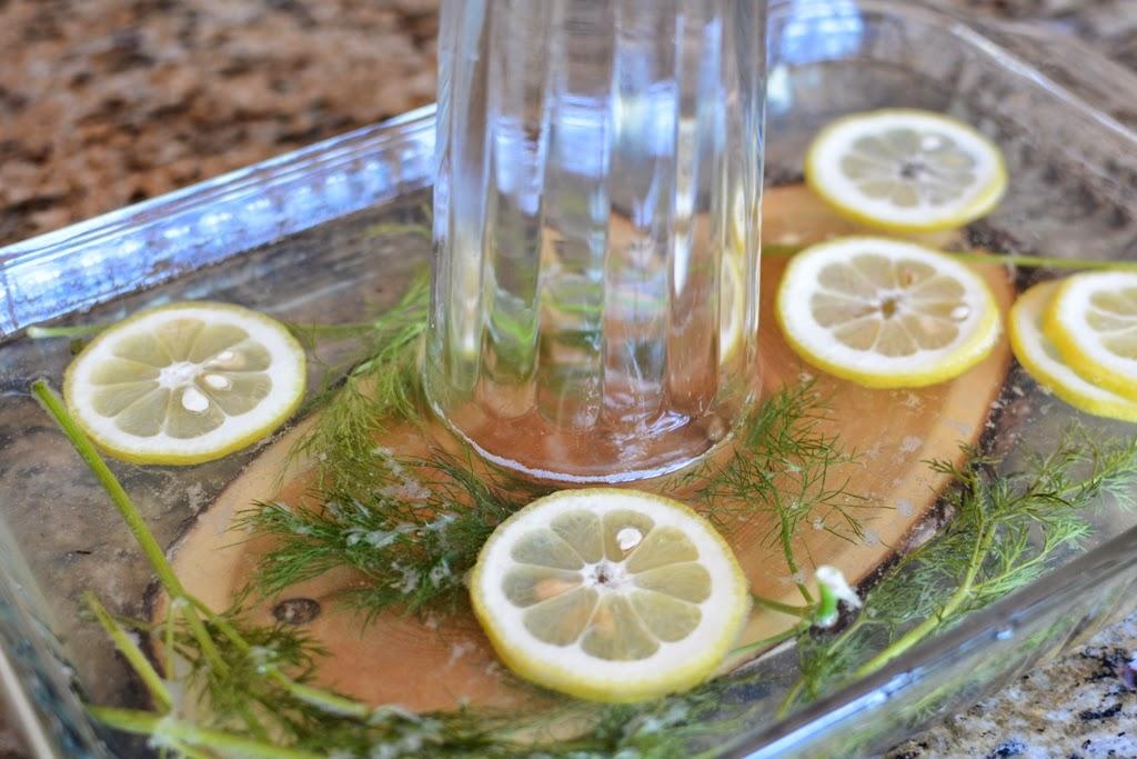 cedar plank soaking in water with herbs