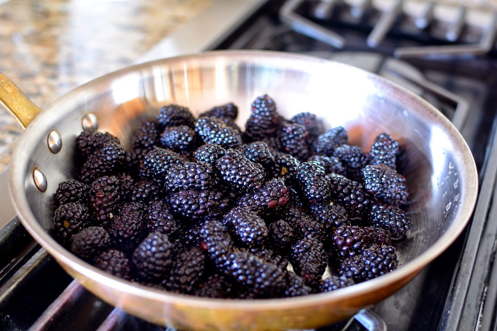 skillet filled with blackberries