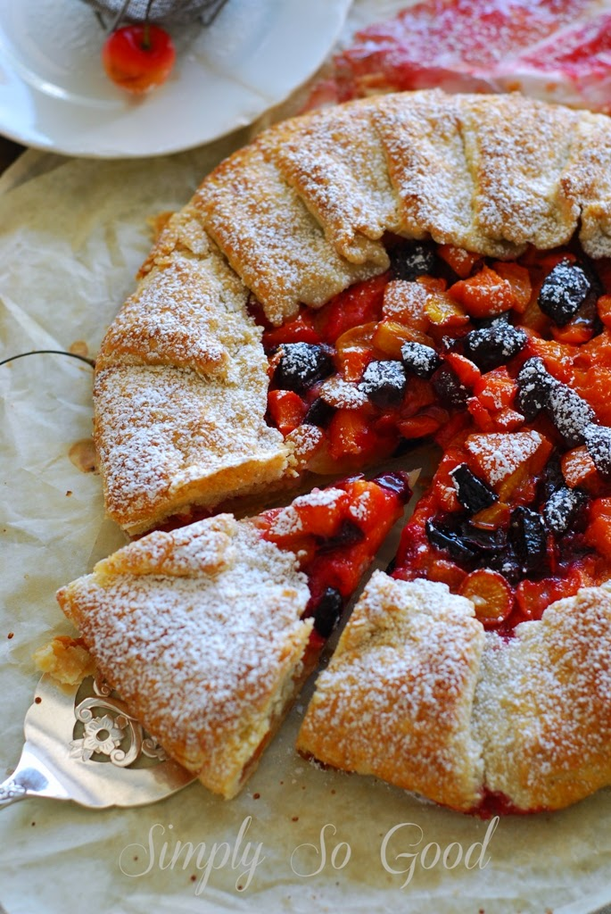 cherry apricot galette with a slice cut on a pie server