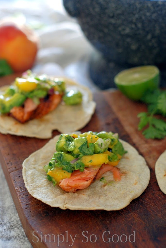 salmon tacos on wooden board