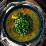 Soup in bowl with chopped kale