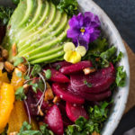 Avocado, beets, oranges on kale