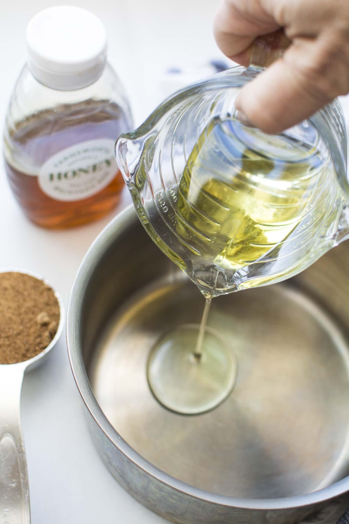 Oil pouring into a saucepan