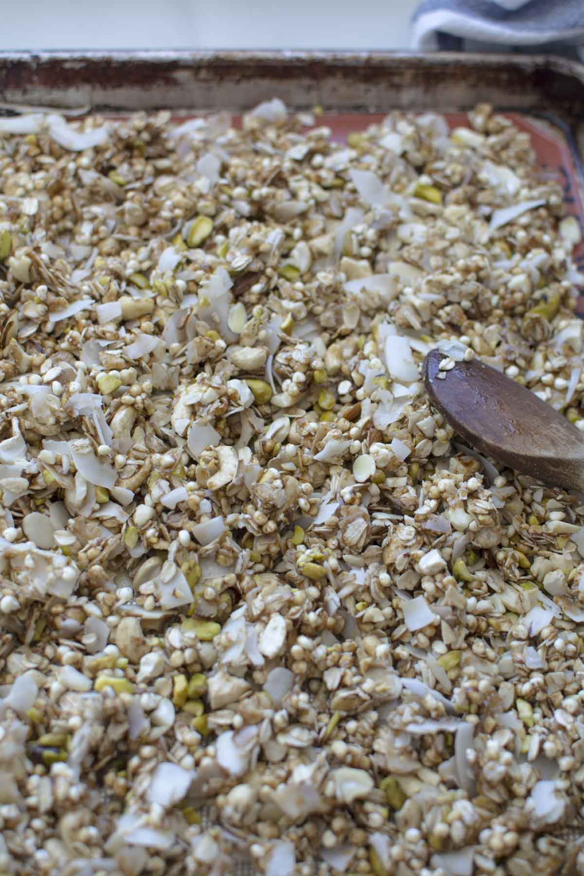 granola spread on baking sheet