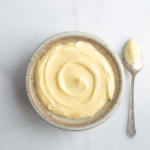 Velvety Vanilla pastry cream in a bowl with a spoon