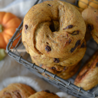 No-Knead Pumpkin Chocolate Chip Bagels stacked in wire basket