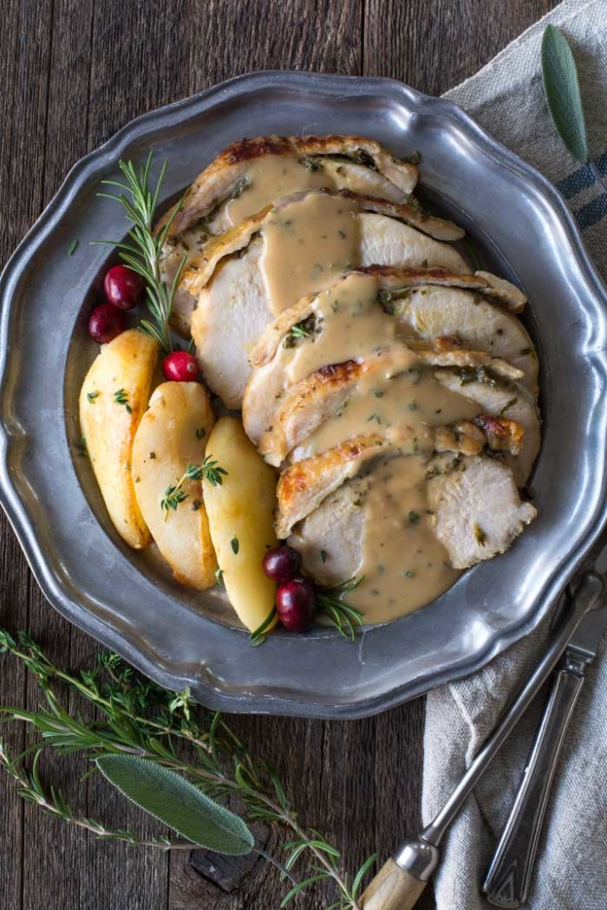 Fresh Herb Crockpot Turkey Breast with Brown Butter Pears on a platter