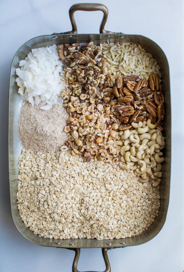 oats, nuts, coconut in baking pan