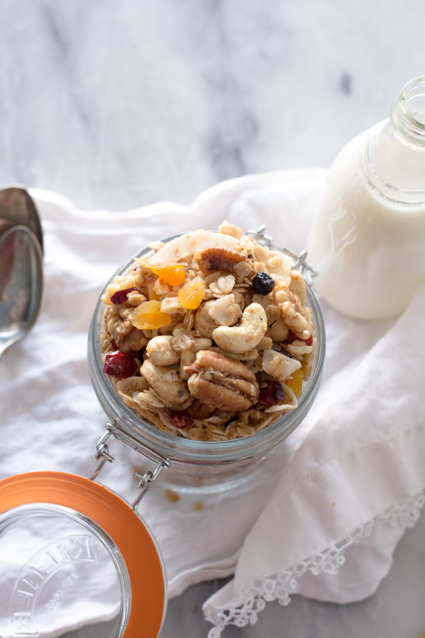 granola in glass jar bottle of milk