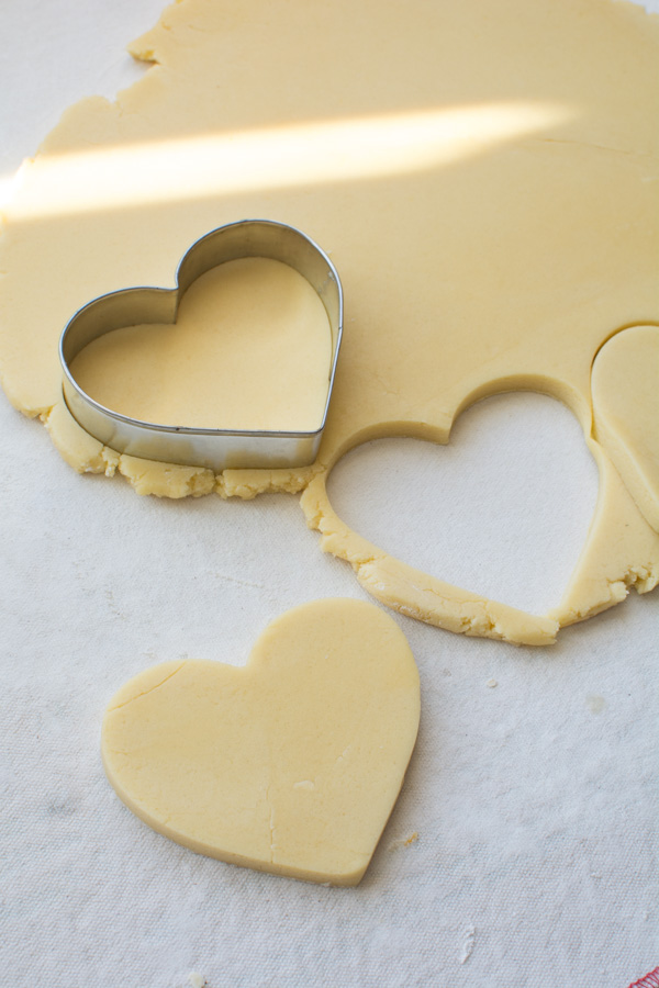 Rolled out dough cut into hearts