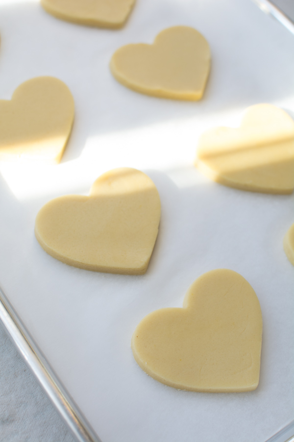 heart shaped cookies on baking sheet