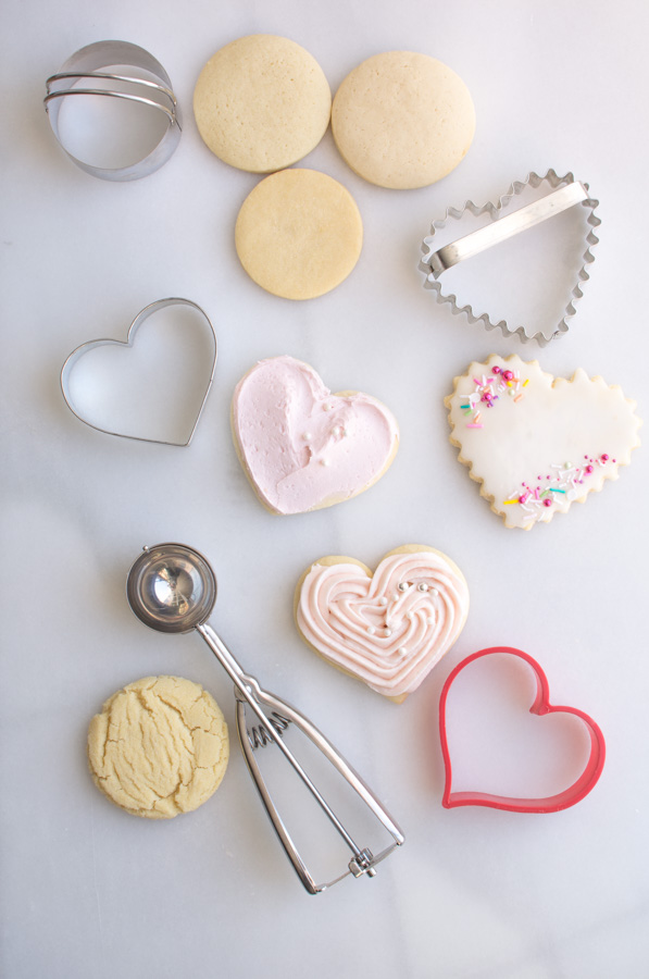 assortment of sugar cookies and cutters