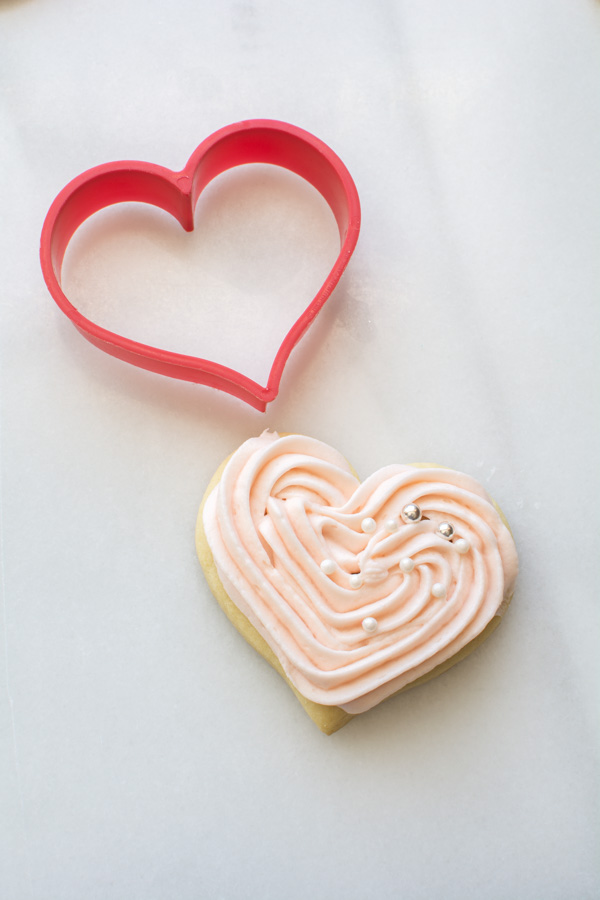 Iced heart sugar cookie with cutter