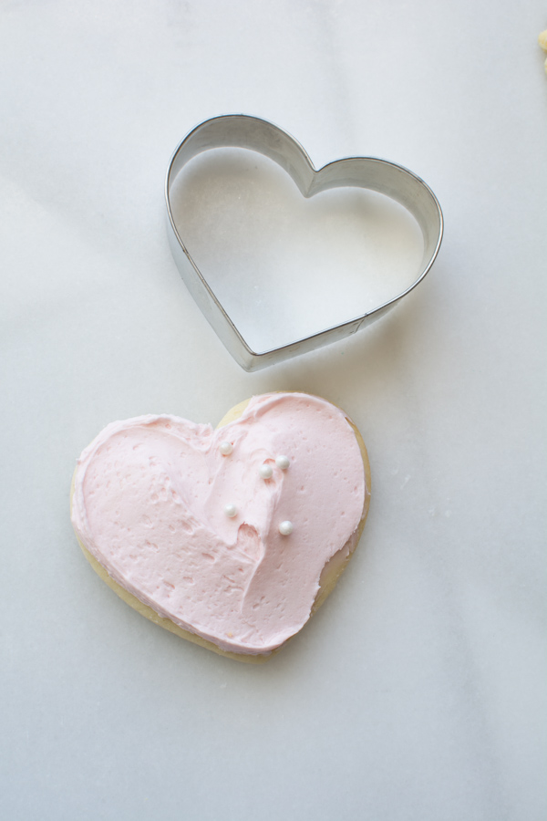 pink iced heart sugar cookie with cutter