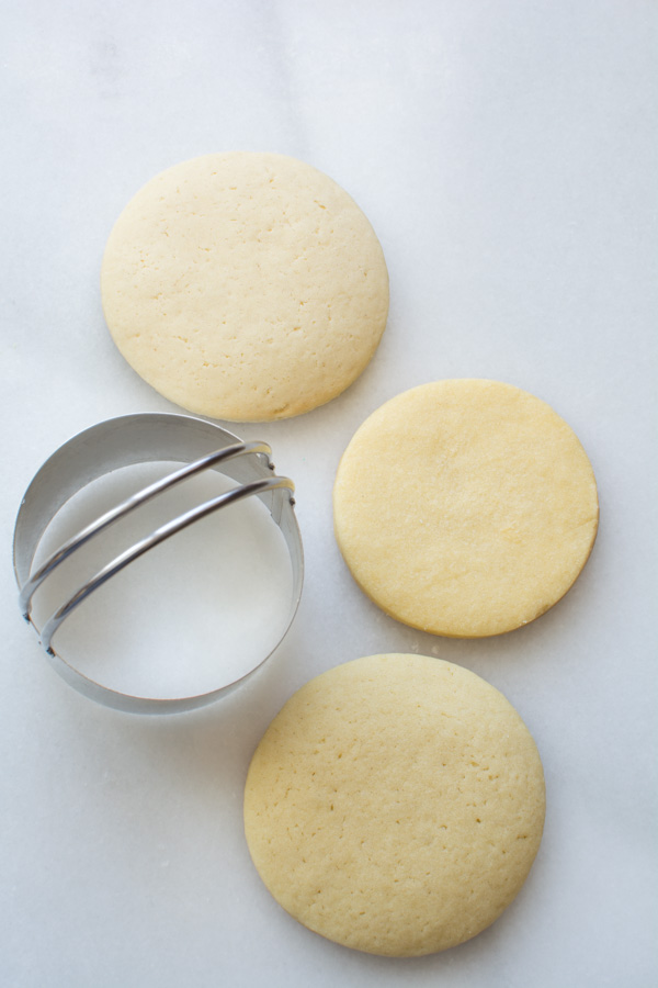 three round sugar cookies with cutter