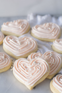 sugar cookies with pink icing and drageé