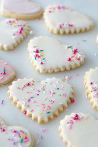 assortment of sprinkles on heart shape sugar cookies