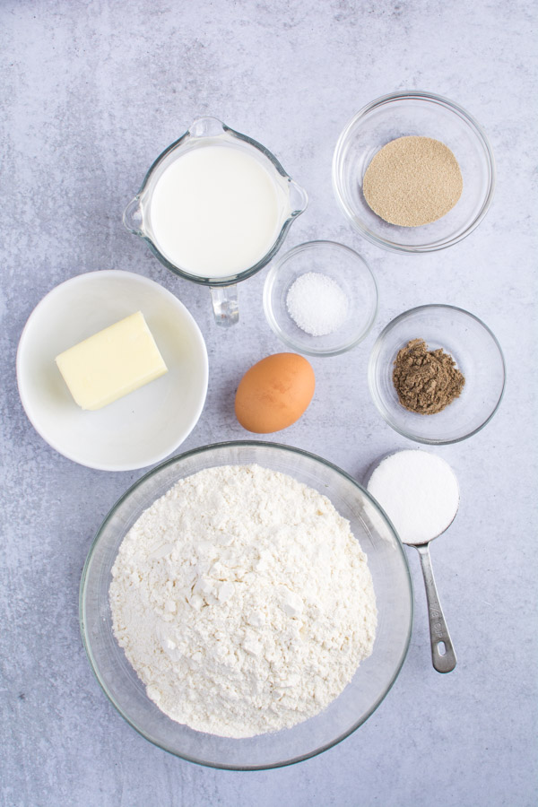 dough ingredients measured in bowls