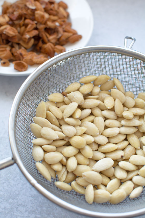 Blanched almonds in strainer