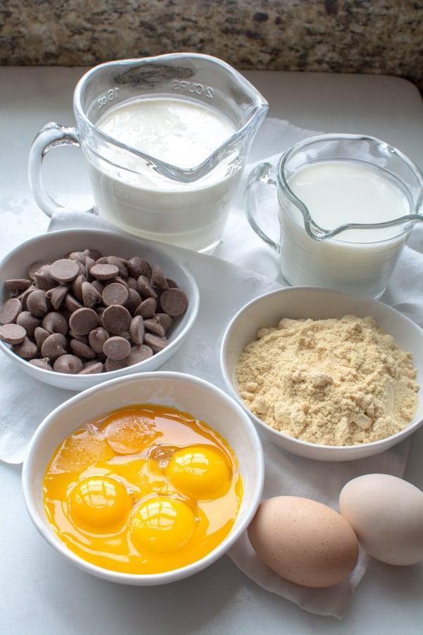 bowls with eggs, malted milk powder, chocolate, cream